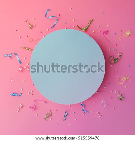 Colorul party streamers on pink background. Celebration concept. Flat lay.