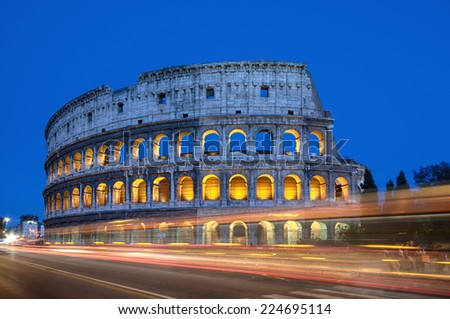 Colosseum at night with colorful blurred traffic lights.Rome - Italy