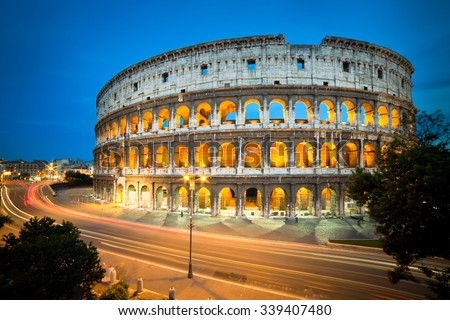 Colosseum at night with colorful blurred traffic lights. Rome - Italy. - stock photo
