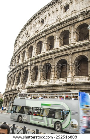 Colosseum (Coliseum) in Rome, Italy The Colosseum is an important monument of antiquity and is one of the main tourist attractions of Rome world European architectural attractions Double decker bus - stock photo