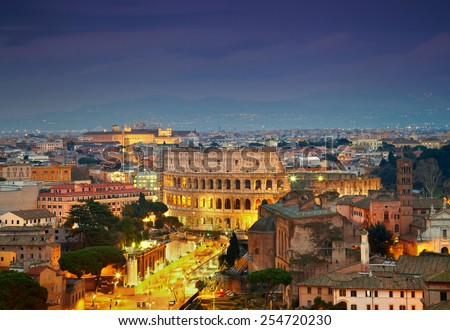 Colosseum in Rome after sunse with citylights - stock photo