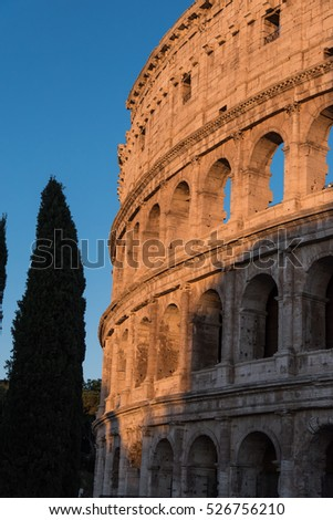Colosseum in Rome Italy at sunset with partial shading of building