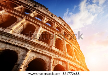 Colosseum in Rome, Italy. Symbol of the ancient city. Amphitheatre in sunset light.  - stock photo
