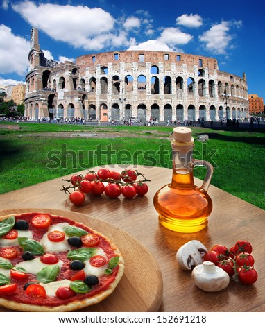 Colosseum in Rome with traditional pizza in Italy - stock photo