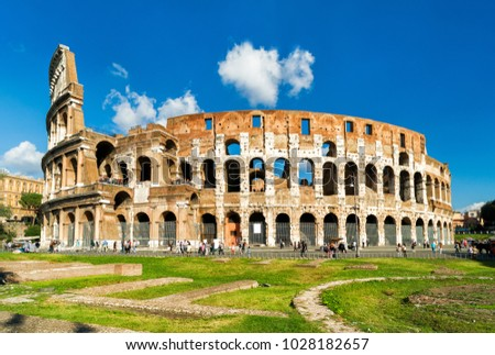 Colosseum or Coliseum in Rome, Italy. It is the main travel attraction of Rome. Colosseum in the sunlight. Rome landmark. Historical architecture and ruins in central Rome.