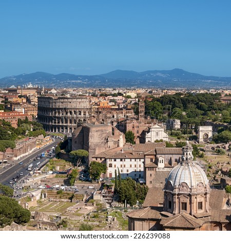 Colosseum, Rome - Italy. Ariel view of Rome: including the Colosseum and Roman Forum.   - stock photo