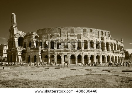 Colosseum surrounded by crowds of people in sunny day Rome, Italy