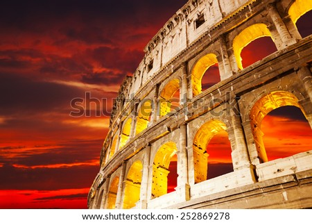 Colosseum wall against a sunset, Rome, Italy - stock photo