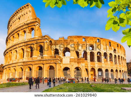 Colosseum with green leaves in Rome, Italy - stock photo