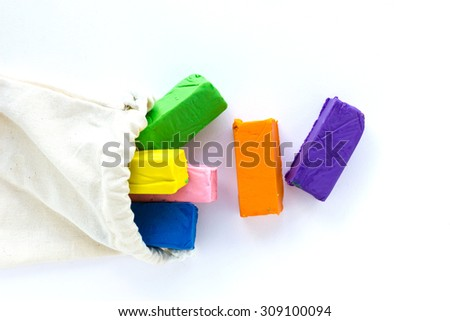Colour clay sticks on white background, children's education craft product. - stock photo