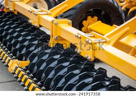 Colour detail of heavy farming equipment - stock photo