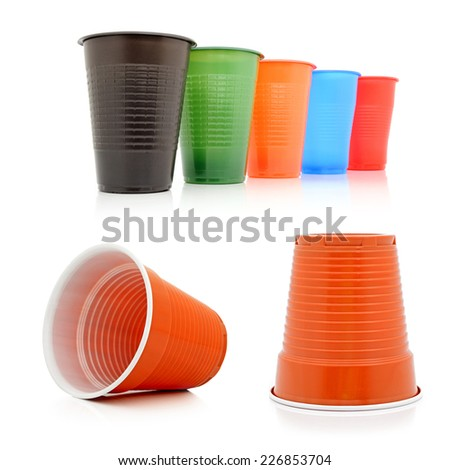 Colour disposable glasses on a white background. Collage - stock photo