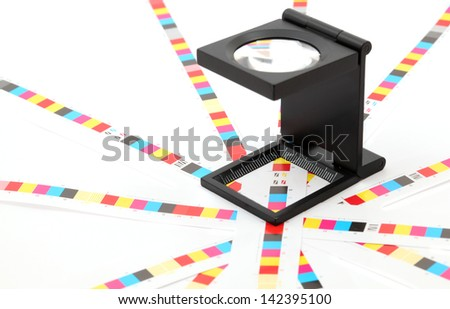 Colour management - loupe and calibration chart. - stock photo