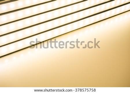 colour of led rigid strip lighht : Row of led light line on  light yellow - stock photo