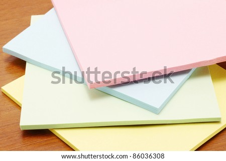 Colour paper on a wooden background