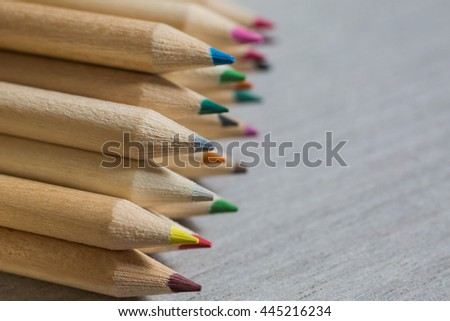 Colour pencils,  flat lay, colored pencils lay in row, school design, items for school design, colored flat education tools, copyspace, crayons   - stock photo