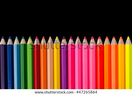 Colour pencils isolated on black background - stock photo