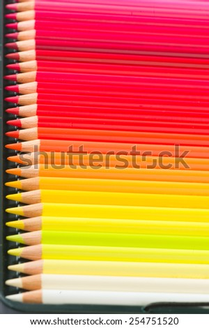 Colour pencils isolated on white background close up - stock photo