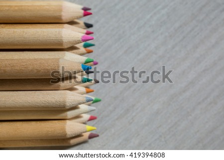 Colour pencils,  school design, items for school design, colored flat education tools, long items for writing, drawing, creativity, pencils lying in a row   - stock photo