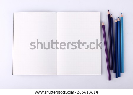 Colour pencils with blank notebook isolated on white background,theme color - stock photo