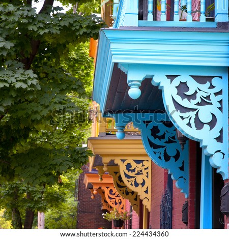 Colour porches and balconies on a street in Montreal, Canada - stock photo