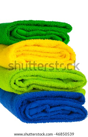 Colour terry towels combined by pile on white background.  isolated