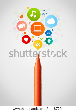 Coloured crayon close-up with social network icons - stock photo
