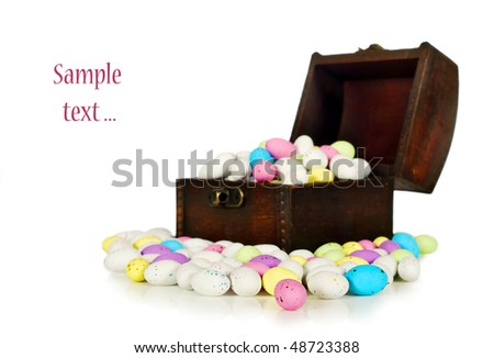 Coloured easter eggs in a treasure chest on a pure white background with space for text
