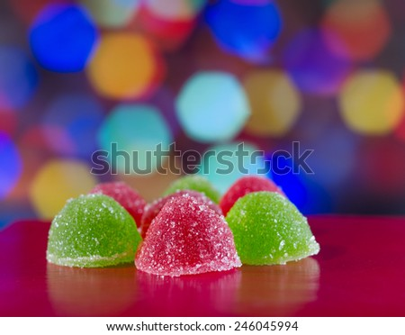 Coloured jelly sweets on abstract background - stock photo