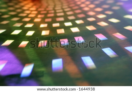 coloured light reflected from a disco ball on paper - stock photo