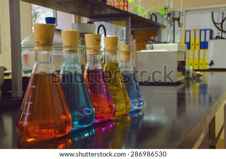 Coloured liquds in the flasks of a laboratory. Chemistry and biochemistry concept. Chemical laboratory - stock photo
