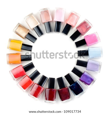 Coloured nail polish bottles stacked circle on a white background - stock photo
