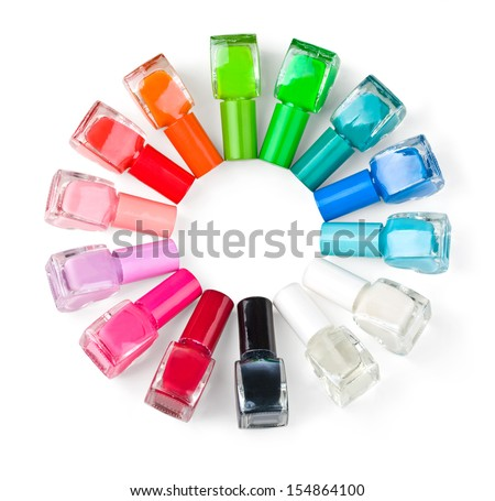 Coloured nail polish bottles stacked circle on a white background.With clipping path - stock photo