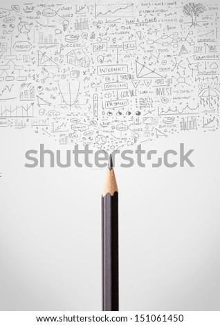 Coloured pencil close-up with sketchy diagrams - stock photo