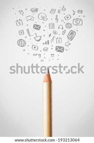 Coloured pencil close-up with sketchy social media icons - stock photo