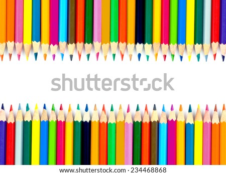 Coloured pencils on white background - stock photo