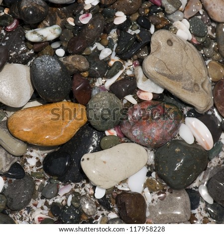 Coloured stones and pebbles along the shoreline in Costa Rica