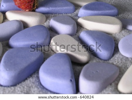 Coloured stones on the sand