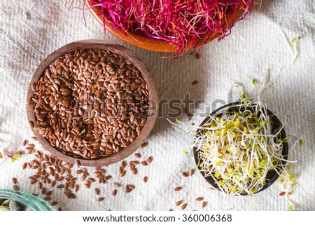 Colourful and healthy crunchy mixed seeds and various sprouts. Linseed, alfalfa, red beet sprouts. - stock photo