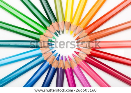 Colourful array of art pencils in creative rainbow spectrum - stock photo