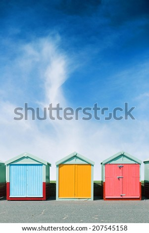 Colourful beach huts in Brighton on the beach