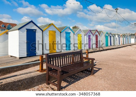 Colourful beach huts on Preston Sands promenade Paignton Torbay Devon England UK Europe - stock photo