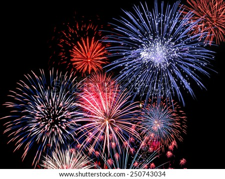 Colourful blue, red and pink fireworks display for celebrations - stock photo
