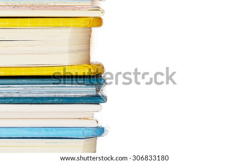 Colourful Books Isolated on White Background. White Background Provides Copy Space to the Right. - stock photo