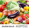 Colourful bright background consists of different vegetables - stock photo