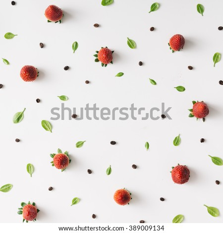 Colourful bright pattern made of strawberries, coffee beans and leaves. - stock photo