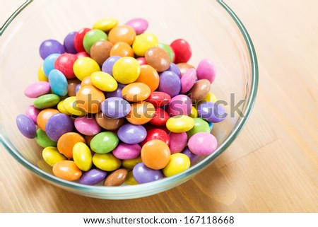 Colourful candy in bowl - stock photo