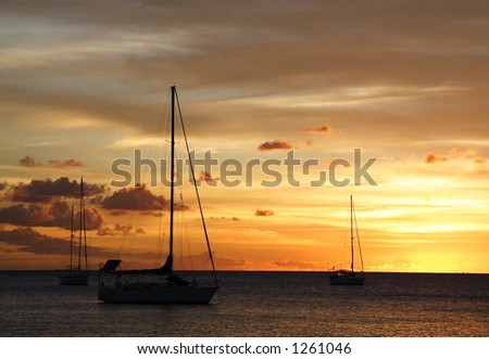 Colourful caribbean sunset with sailboats