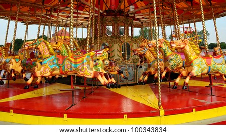 Colourful carnival Horses on a merry-go-round carousel - stock photo