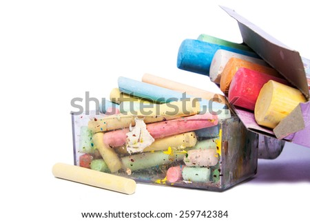 colourful chalks in a box on a white background - stock photo